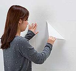 専用両面テープ(RYO-1)の白い離けい紙をゆっくりはがして、